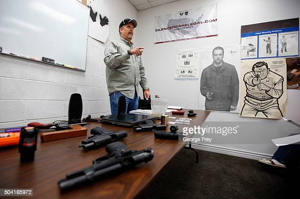 Gun instructor Mike Stilwell teaches a packed class to obtain the Utah concealed gun carry permit at Range Master of Utah on January 9 2016 in...