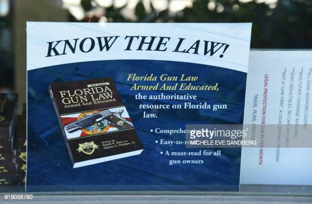 A gun law sign from the Florida state is seen on the window of Sunrise Tactical Supply store in Coral Springs Florida on February 16 2018 where...