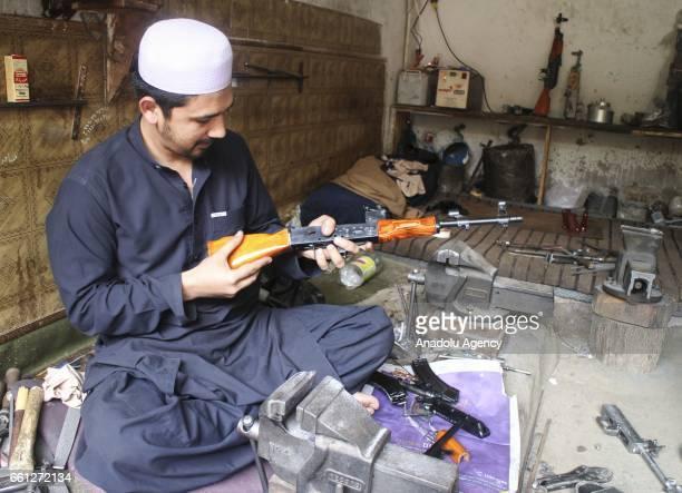 A gun manufacturer is seen at his shop in Darra Adam Khel village Peshawar Pakistan on March 30 2017 Most of the Darra Adam Khel villagers earn their...