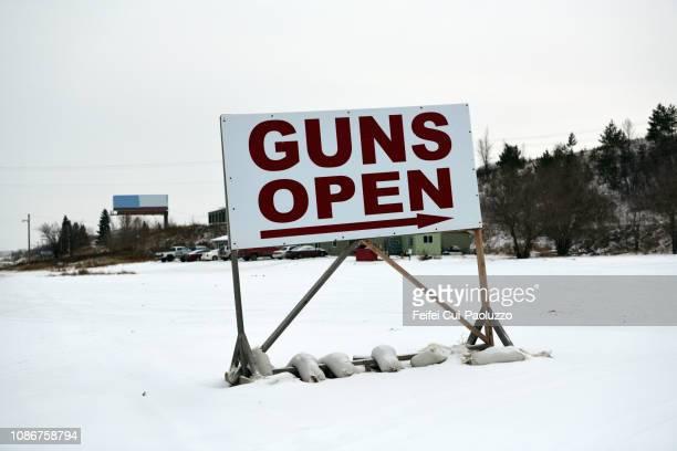 Gun open sign at Minot, North Dakota, USA