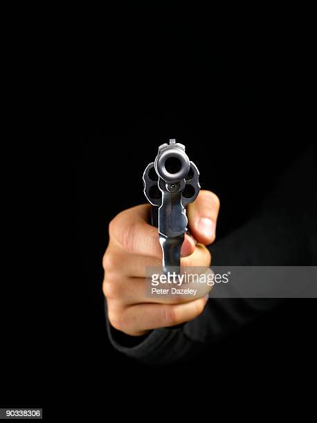 gun pointing at camera on black background. - handgun stock pictures, royalty-free photos & images