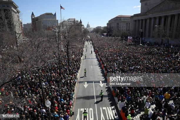 Gun reform advocates line Pennsylvania Avenue while attending the March for Our Lives rally March 24, 2018 in Washington, DC. Hundreds of thousands...