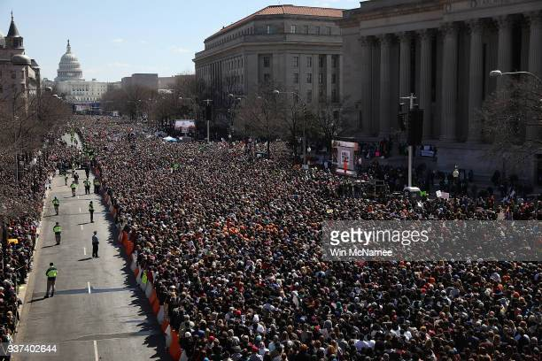 Gun reform advocates line Pennsylvania Avenue while attending the March for Our Lives rally March 24 2018 in Washington DC Hundreds of thousands of...