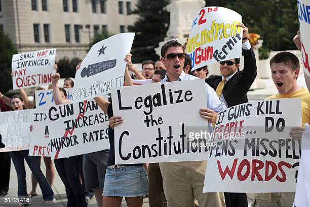 Gun rights activist cheer upon hearing the news from US Supreme Court June 26 2008 that Americans have a constitutional right to bear arms ending a...