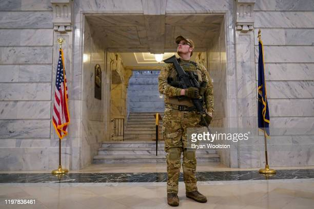 Gun rights activist Cory Buckholtz holds a semiautomatic rifle while standing in the rotunda of the Capitol Building on January 31 2020 in Frankfort...