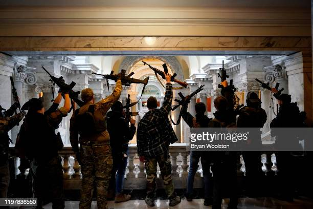 Gun rights activists carrying semi-automatic firearms pose for a photograph in the Capitol Building on January 31, 2020 in Frankfort, Kentucky....