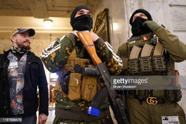 Gun rights activists carrying semiautomatic firearms stand in the rotunda of the Capitol Building on January 31 2020 in Frankfort Kentucky Advocates...