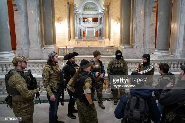 Gun rights activists carrying semiautomatic firearms stand in the Capitol Building on January 31 2020 in Frankfort Kentucky Advocates from across the...