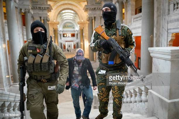 Gun rights activists carrying semiautomatic firearms walk through the Capitol Building on January 31 2020 in Frankfort Kentucky Advocates from across...