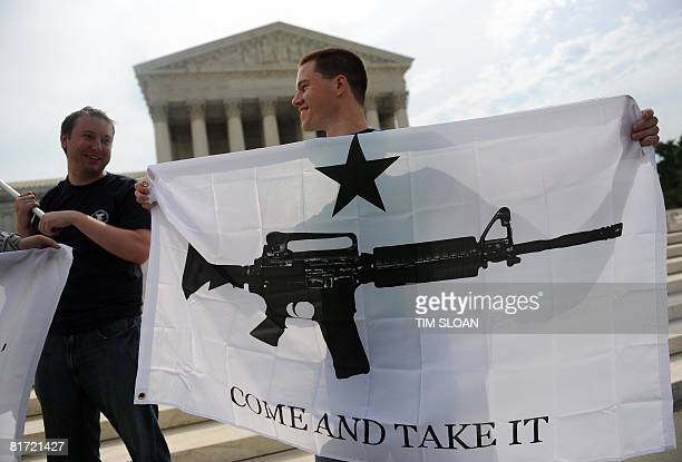 Gun rights activists celebrate the news from US Supreme Court June 26 2008 that Americans have a constitutional right to bear arms ending a ban on...