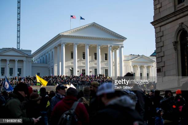 Gun rights advocates attend a rally organized by The Virginia Citizens Defense League on Capitol Square near the state capitol building on January 20...