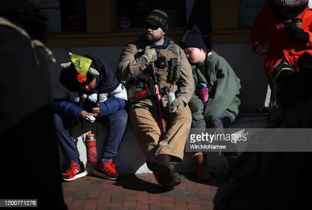 Gun rights advocates attend a rally organized by The Virginia Citizens Defense League on Capitol Square near the state capitol building January 20...