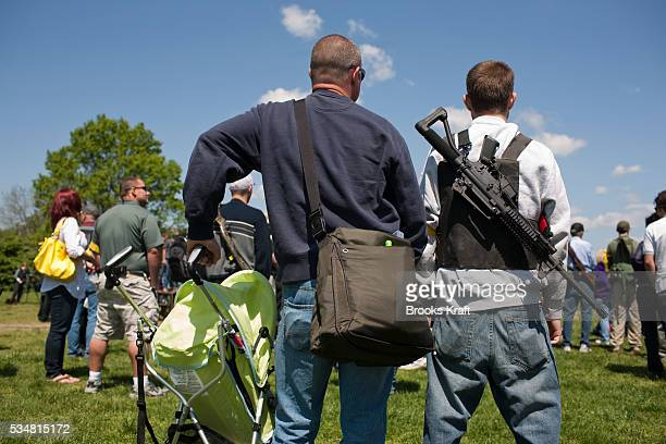 Gun rights groups gather across the Potomac River from the nation's capital for an 'Open Carry Rally' in Arlington Virginia The groups gathered in a...
