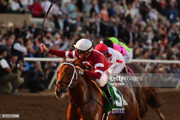Gun Runner ridden by Florent Geroux defeats Collected ridden by Martin Garcia and West Coast ridden by Javier Castellano to win the Breeders' Cup...