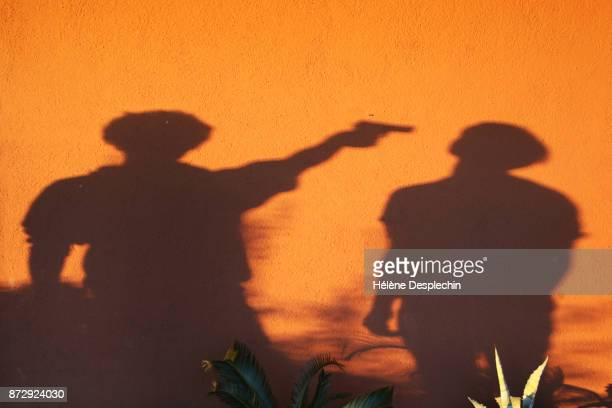 gun shot - shooting a weapon stock pictures, royalty-free photos & images