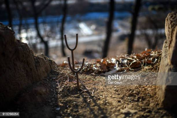 A gun support is fixed into a gun emplacement in an operational trench system overlooking the main highway leading towards North Korea near the...
