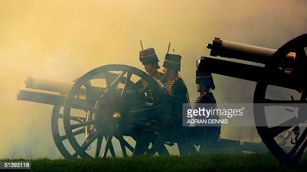 A gun team from The Kings Troop of the Royal Artillery are shrouded in smoke after firing a Royal Salute in Hyde Park in London 06 February 2001The...