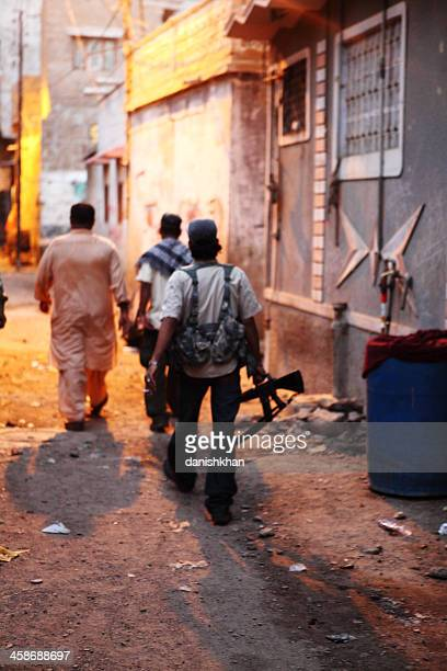gun toting militants of lyari underworld gangs in karachi - terrorism stock pictures, royalty-free photos & images