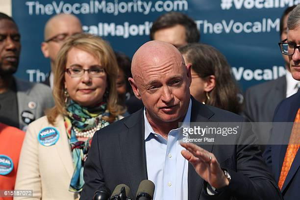 Gun violence victim and former US Congresswoman Gabby Giffords watches her husband NASA astronaut Mark Kelly speak as they visits City Hall on her...