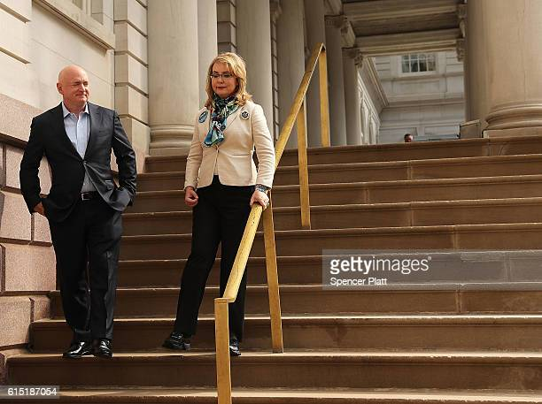 Gun violence victim and former US Congresswoman Gabby Giffords walks with her husband NASA astronaut Mark Kelly as they visit City Hall on her 2016...