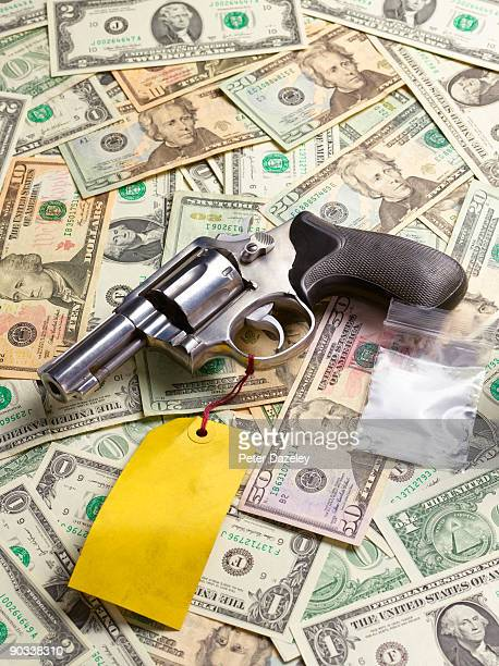 gun with drug money and bag of cocaine close up - gun stock pictures, royalty-free photos & images