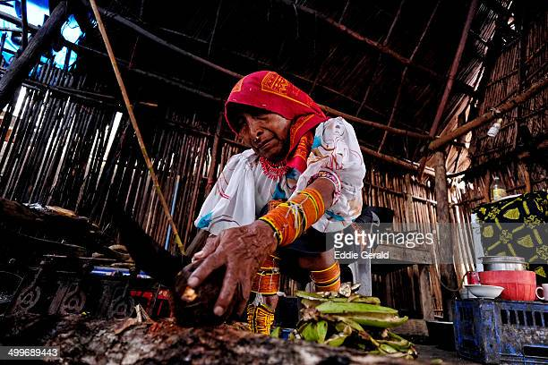 Guna Yala woman in traditional garment preparing food in a stitched hut in Carti Sugtupu island in San Blas Islands an indigenous province of the...