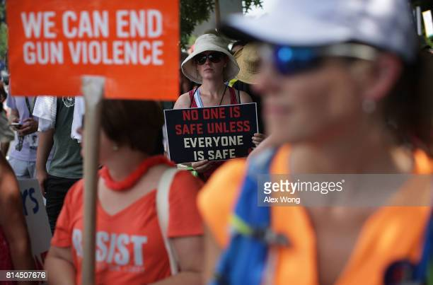 Guncontrol activists participate in a rally outside the headquarters of National Rifle Association July 14 2017 in Fairfax Virginia Women's March...