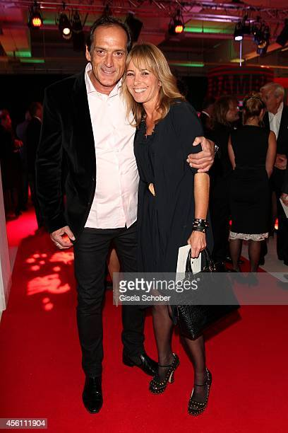Gundis Zambo r and Christoph Mahrdt arrive at Tribute To Bambi 2014 at Station on September 25 2014 in Berlin Germany