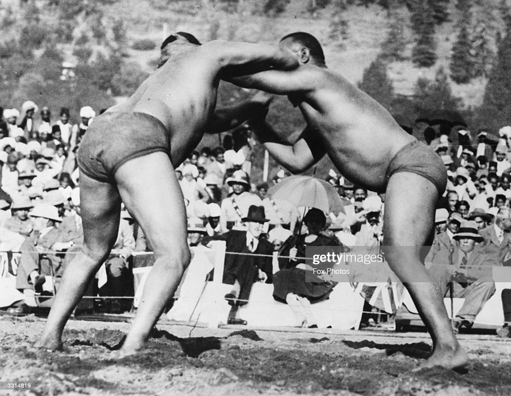 Gunga and Sohan Singh wrestling in front of the Viceroy of India and Lady Chetwood at the Punjab Mela a religious festival held at Annandale