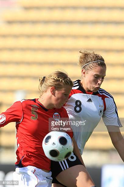 Gunhild Herregarden of Norway and Kim Kulig of Germany fight for the ball during the Women's U19 European Championship match between Germany and...