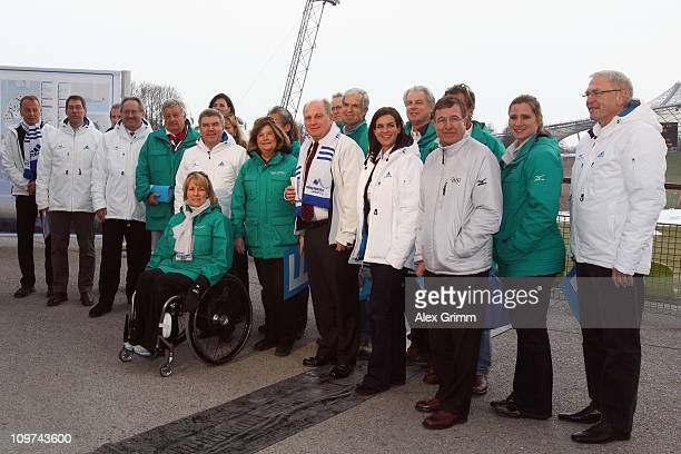 Gunilla Lindberg and the IOC Evaluation Commission pose with Katarina Witt Uli Hoeness mayor Christian Ude and Thomas Bach head of Germany's DOSB in...