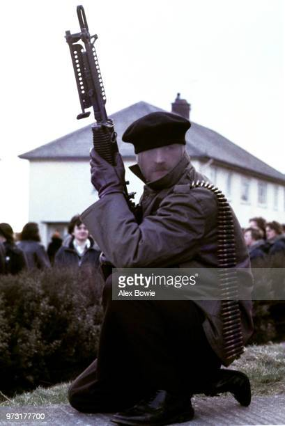 A gunman from the Provisional Irish Republican Army holds a USmade M60 machine gun during a demonstration in the Republican Creggan estate in...