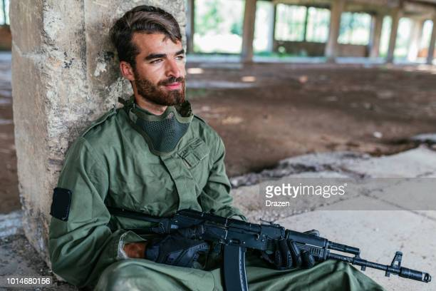 Gunman resting after battle in airsoft sport