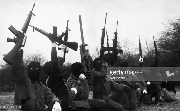 IRA gunmen pose during a training and propaganda exercise in Northern Ireland 12 February 1977