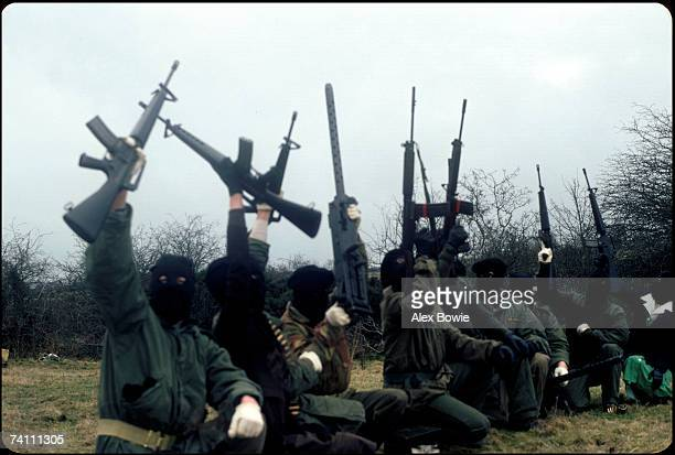 IRA gunmen pose during a training and propaganda exercise in Northern Ireland 12th February 1977
