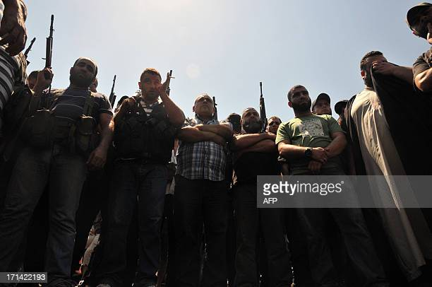 Gunmen take part in a protest in support of Lebanon's radical Sunni cleric Sheikh Ahmad alAssir in the central Nur square in the northern city of...