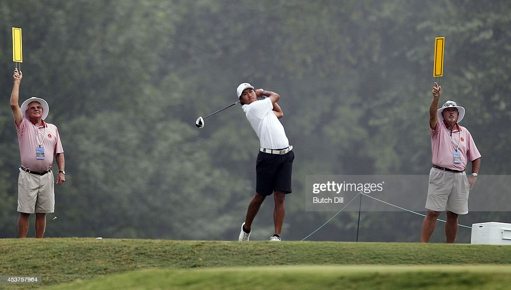 Gunn Yang of Korea watches his tee shot on the fourteenth hole during the final match of the U.S. Amateur Championship on August 17, 2014 at the Atlanta Athletic Club in Johns Creek, Georgia.