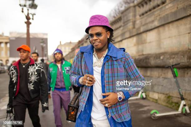 Gunna is seen attending Louis Vuitton during Men's Paris Fashion Week AW19 wearing blue plaid jacket blue long coat white shirt pants and sneakers on...