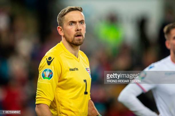 Gunnar Faroes' goalkeeper Gunnar Nielsen reacts during the UEFA Euro 2020 Group F qualification football match between Norway and the Faroe Islands...