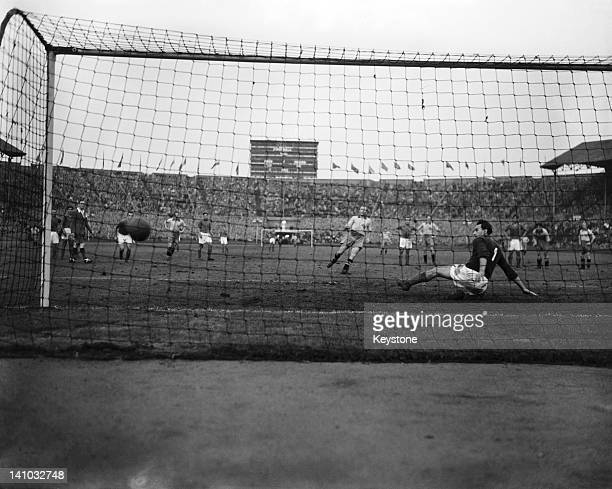 Gunnar Gren scores Sweden's third goal against Yugoslavia from a penalty in the 67th minute of the football final at the Olympic Games Wembley...