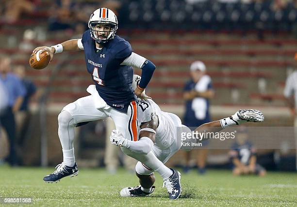 Gunnar Holcombe of the Tennessee-Martin Skyhawks is sacked by Eric Wilson of the Cincinnati Bearcats during the third quarter at Nippert Stadium on...