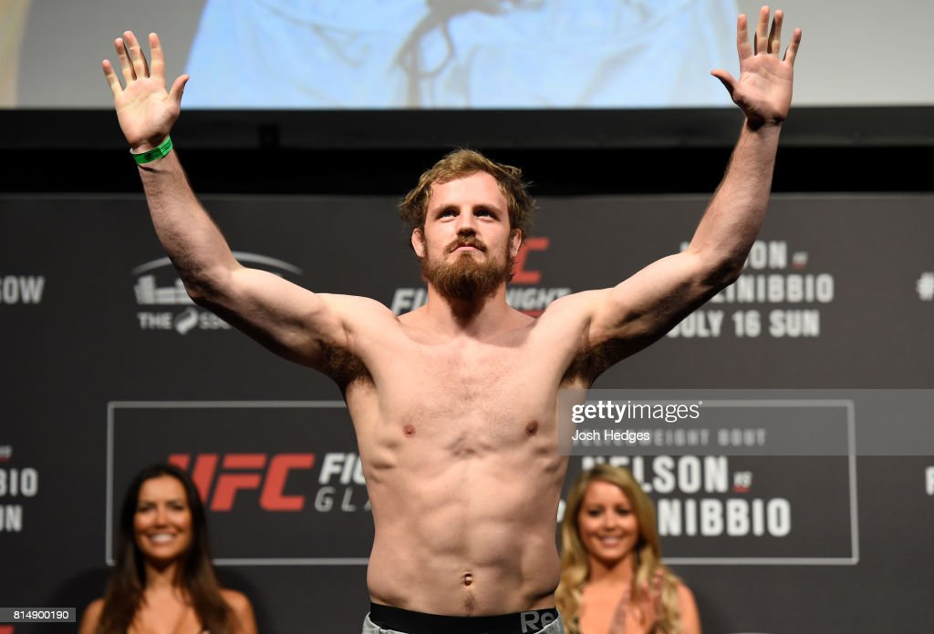 Gunnar Nelson of Iceland poses on the scale during the UFC Fight Night weigh-in at the SSE Hydro Arena Glasgow on July 15, 2017 in Glasgow, Scotland.