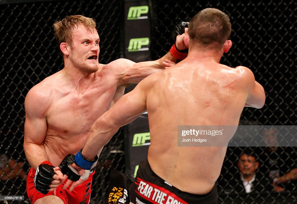 Gunnar Nelson of Iceland punches Rick Story in their welterweight bout at the Ericsson Globe Arena on October 4, 2014 in Stockholm, Sweden.