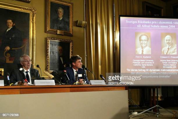 Gunnar Oqvist permanent secretary of the Royal Swedish Academy of Sciences and Professor Torsten Persson present the winners of the 2004 Nobel...