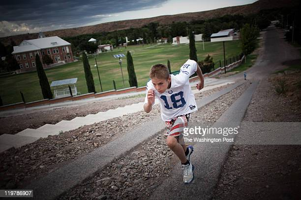 Gunner Romney trains by running up a large hill in Colonia Juarez Mexico in July 2011 United States Presidential candidate Mitt Romney's family...