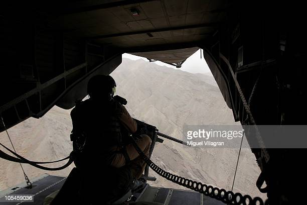 A gunner sits in the back of a CH 53 helicopter during a flight from Feyzabad to MazariSharif on October 14 2010 near Feyzabad Afghanistan Badakhshan...