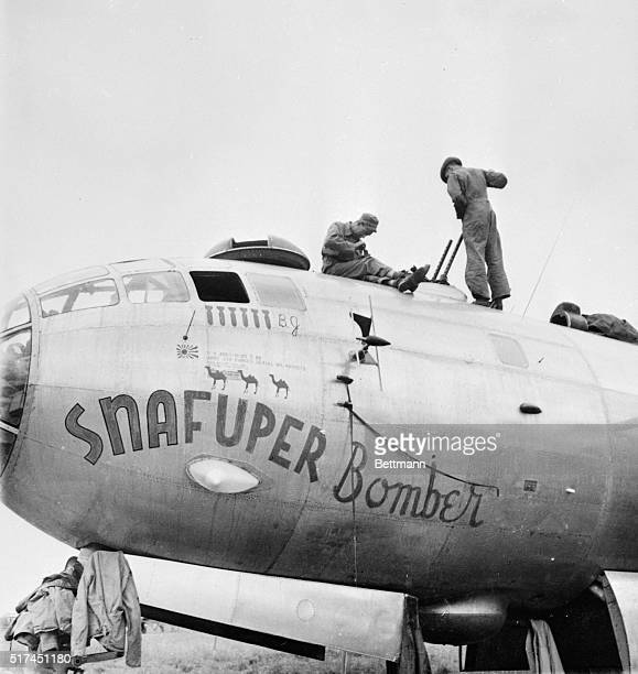 Gunners and mechanics work on the 'Snafuper Bomber' one of the B29 Superfortresses of the 20th Bomber Command under the leadership of Major General...