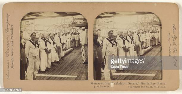 Gunners of the Battleship Oregon, Manila Bay, Philippine Islands; R.Y. Young ; 1899; Hand-colored Albumen silver print.