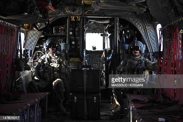 Gunners on board a US CH47 Chinook helicopter are seen during a flight over Kapisa Province on July 4 2012 The French military July 4 handed over a...