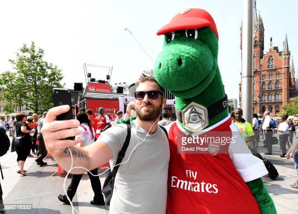 Gunnersaurus the Arsenal mascot attends the new Arsenal Puma Home kit launch at King's Cross St Pancras Station on June 21 2017 in London England